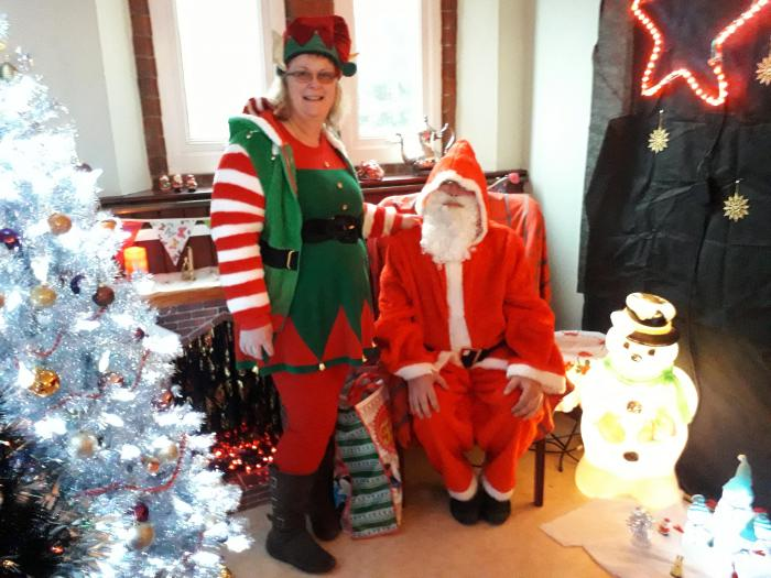 Father Christmas with helper in his grotto